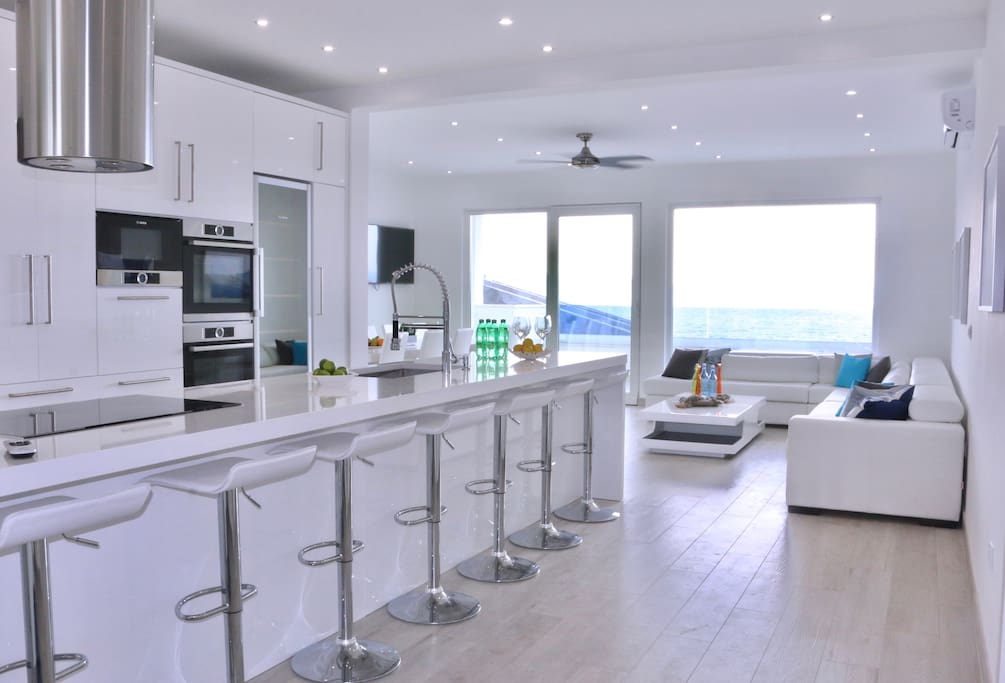 Oversized gourmet kitchen island with living space and sea views