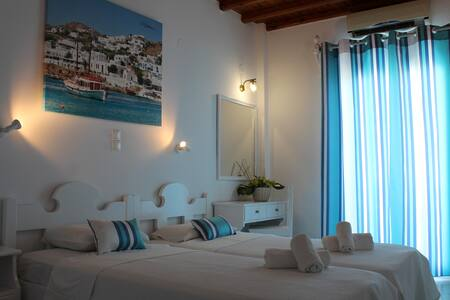 Our rooms with Cycladic architecture style will provide you a beautiful atmosphere perfect for relaxation.