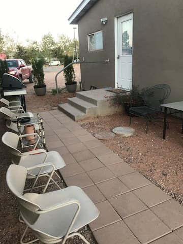 This is the entrance to the bungalow. It has seating and a bbq just outside the kitchen area for your use.  There is a keyless entry on this door and a handicap ramp on the other side of the building at the other entrance.