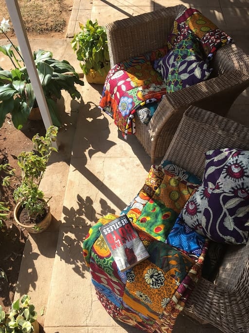 Locally made cane chairs decorated with traditional Malawian fabrics sit on the Khondi, where you can look over the Kasungu mountains and watch the fields in the distance
