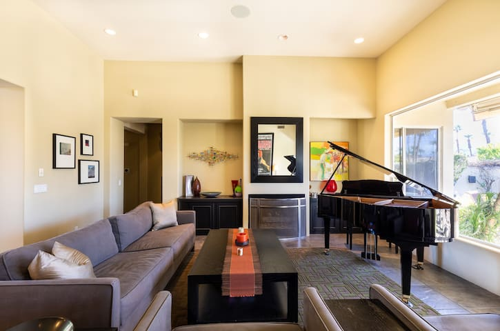 """Yamaha baby grand anchors the living room--plenty of seating and easy to light gas fireplace with """"ember-ific"""" logs!"""