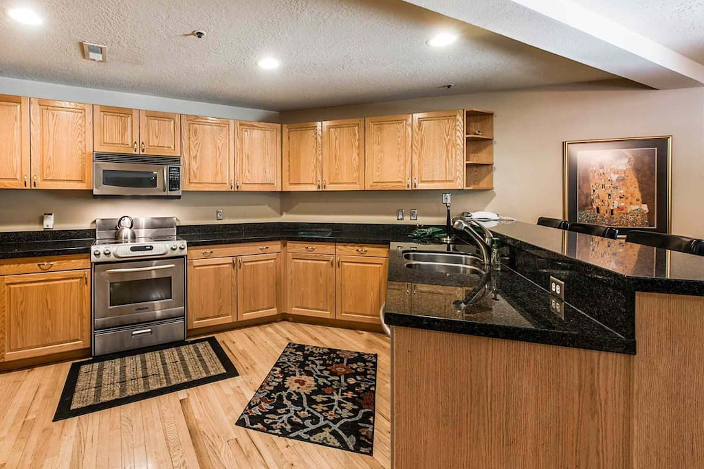 The gourmet kitchen is spacious, renovated and bright and features all new stainless steel appliances, granite counters and breakfast bar.