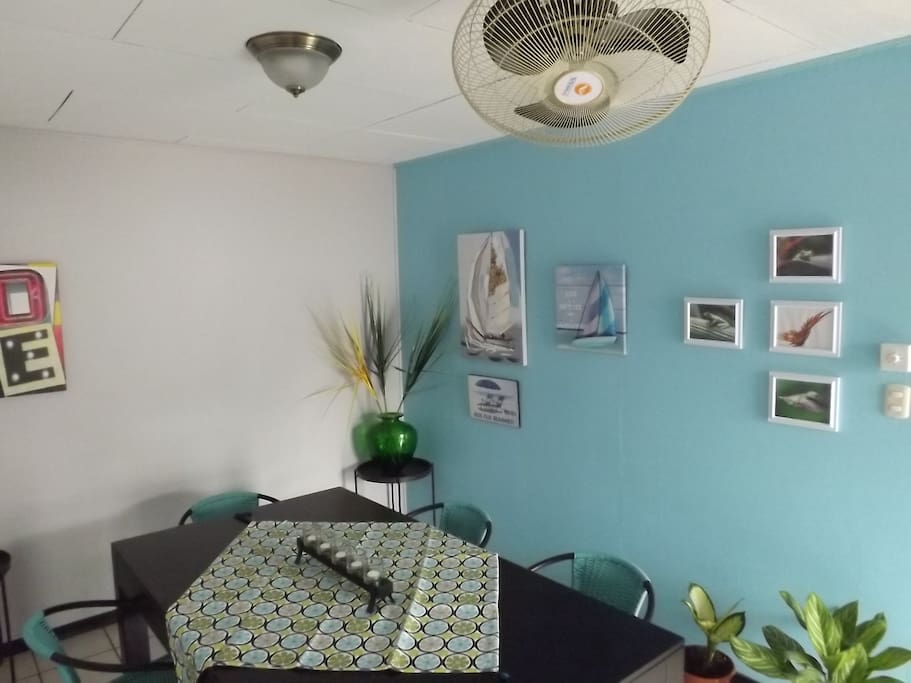 Dining area. To dine, or to work.  Ceiling fans, great natural light. And you'll love the decor!
