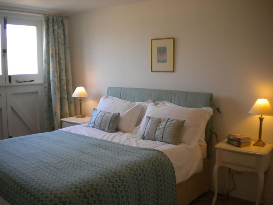 The bedroom is furnished with Laura Ashley fabrics and original tapestries