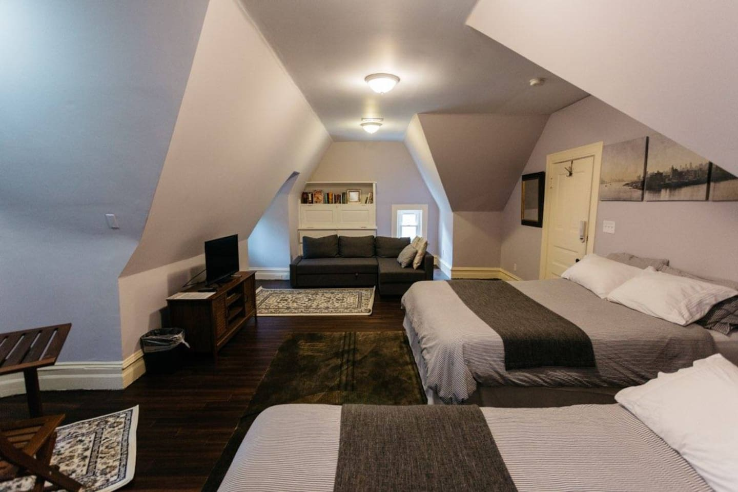 Double Queen Room featuring two Queen beds, pull out sleeper couch, TV with Amazon Fire and all the good streaming services, and breakfast table