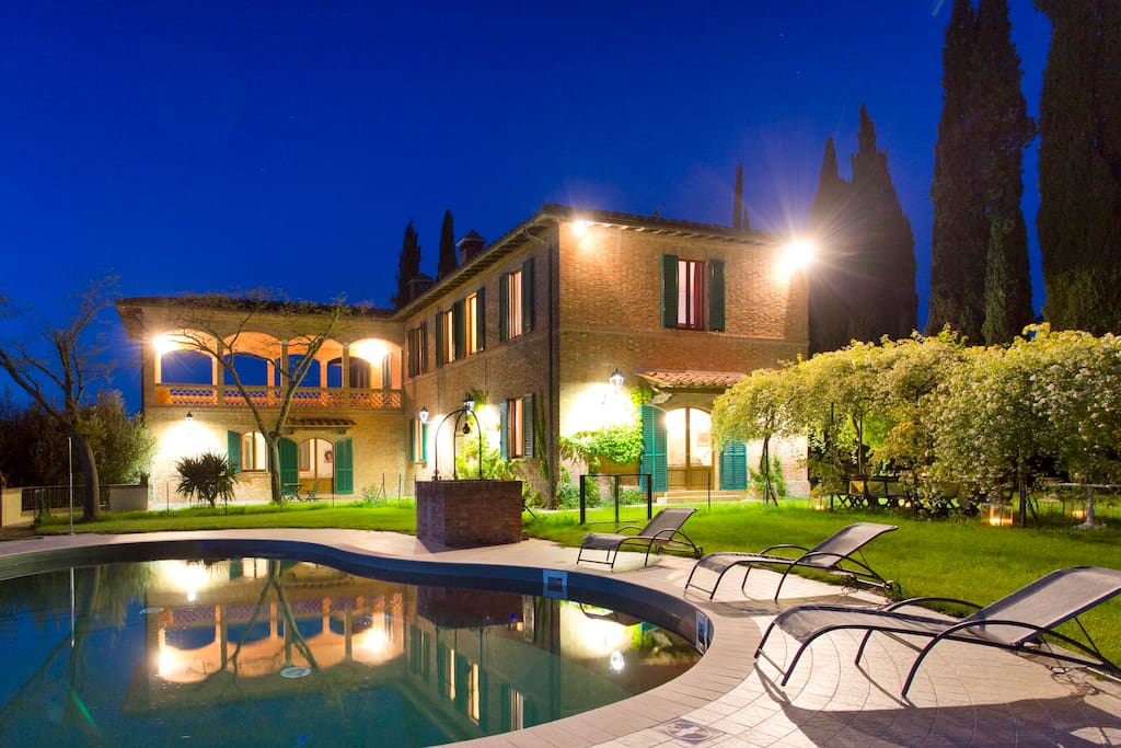 external view of the villa with pool by night