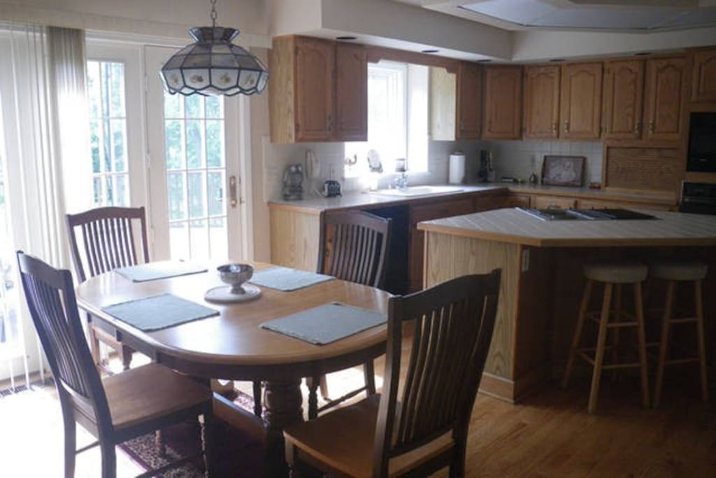 Large eat-in kitchen that is fully stocked.
