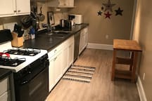 Fully stocked kitchen with gas stove and dishwasher