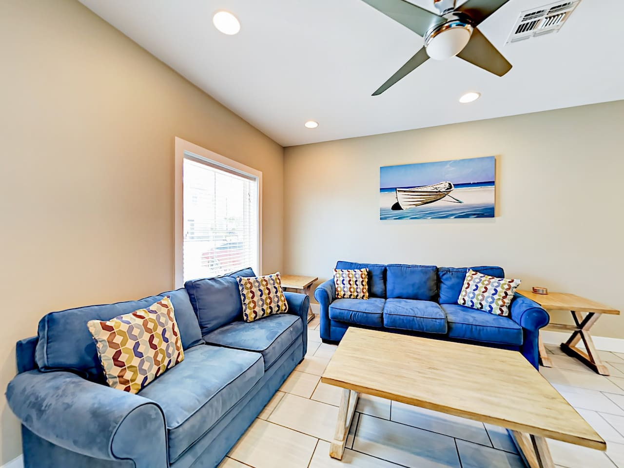 Welcome to Padre Island! The living room offers plush seating on a sofa and a love seat.