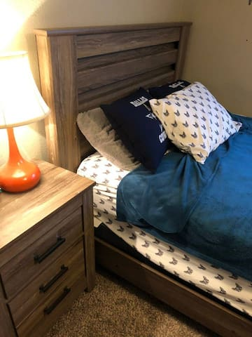 Comfy bed and nightstand