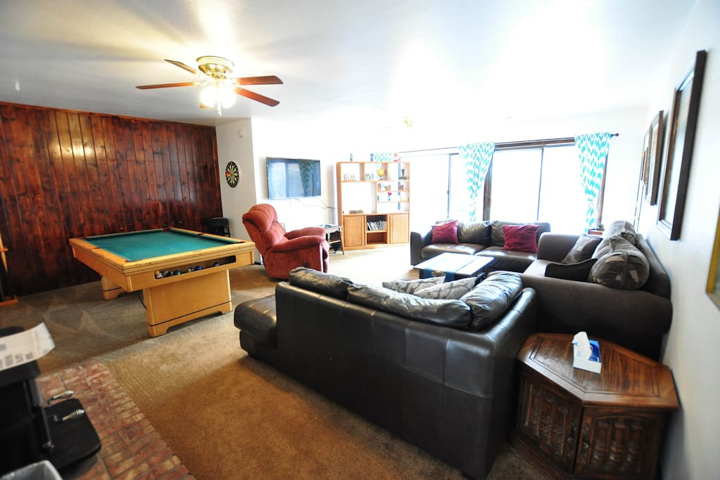 huge spacious living room looks over the spacious fenced in back yard