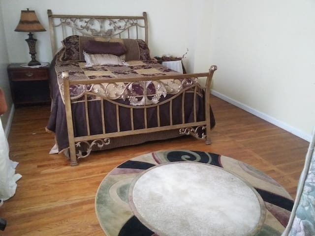 Private Spacious Bedroom in a comfortable home.