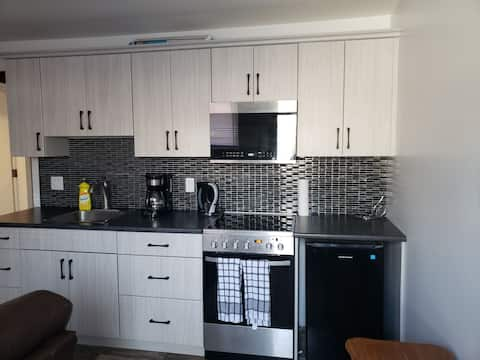 Lovely 1 bedroom apartment with your own parking, laundry and deck.