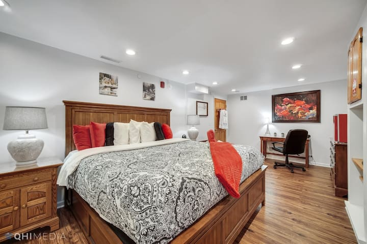 Your bedroom has a beautiful king bed with an oak frame and cotton quilt.  Its decorated in black and white paisley with red and black pillows.  You also have a red massaging recliner, red microwave,  and red mini-fridge in your room.
