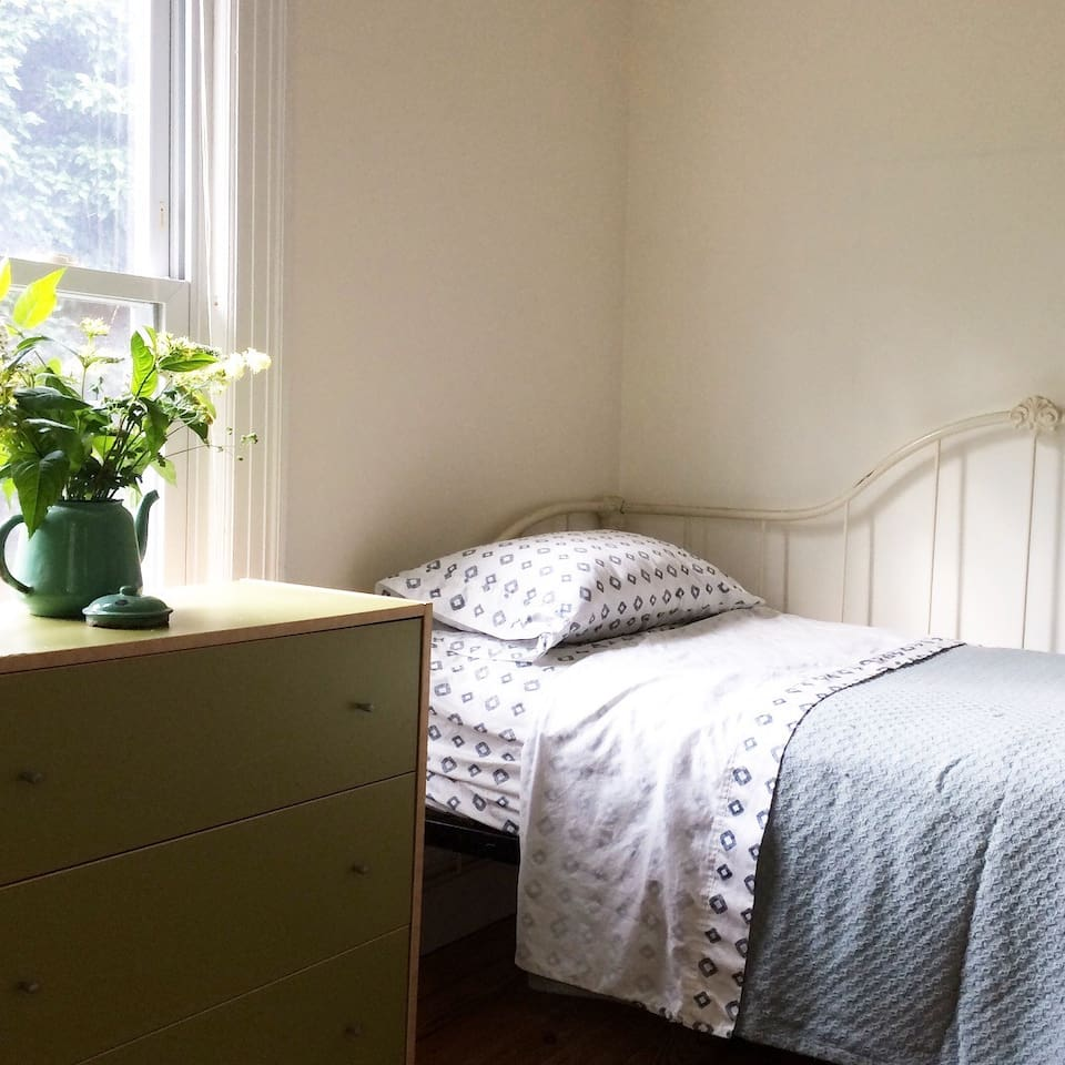 Bedroom 2, with single bed and chest of drawers.