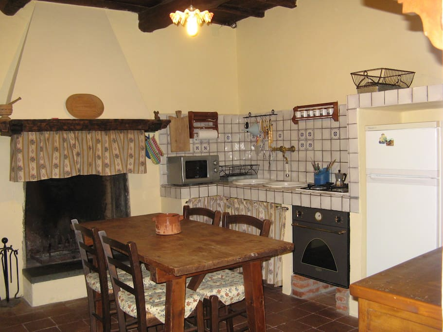 The Kitchen with the fireplace
