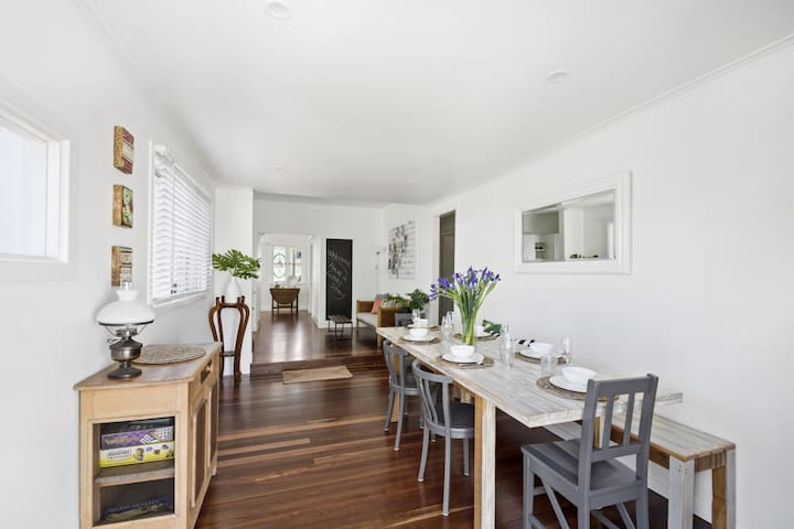 Dining room with long table for entertaining