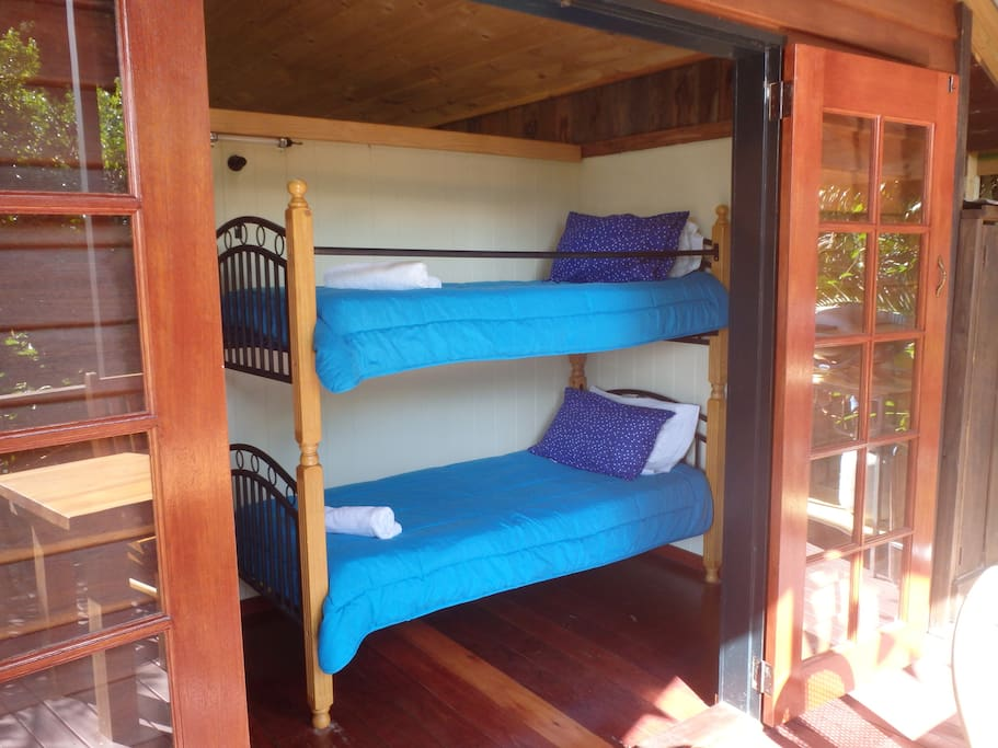 View of bunk beds through the open french doors off side verandah