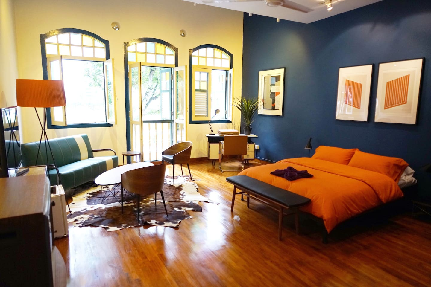 """Latest pictures of our apartment awash in the warm glow of evening light, all set up for you! :)))   Our very own """"Mad Men""""-esque loft to enjoy with a glass of whiskey in hand; filled with the sharp lines and angular curves of original vintage Mid-century Modern furniture pieces;)"""