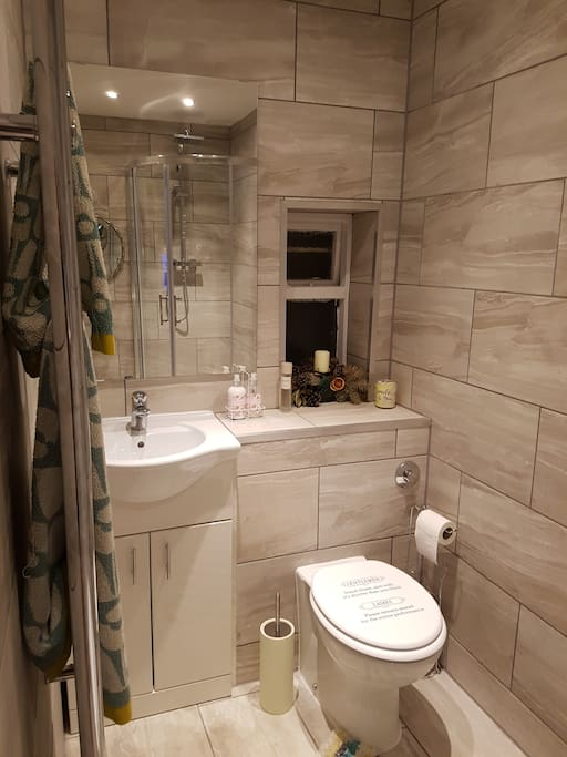 modern bathroom with shower toilet and wash basin