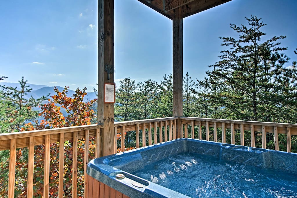 Soak in the hot tub while reveling in the privacy of this gorgeous, idyllic home!
