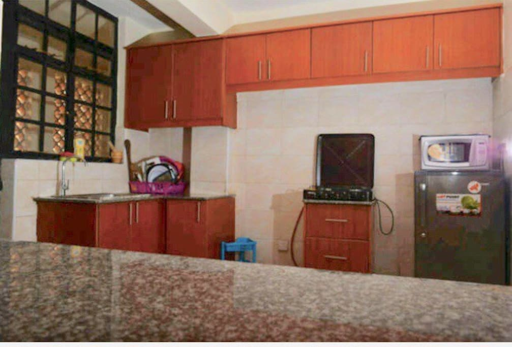 Kitchen with burner,spacious storage,utencils,microwave fridge...