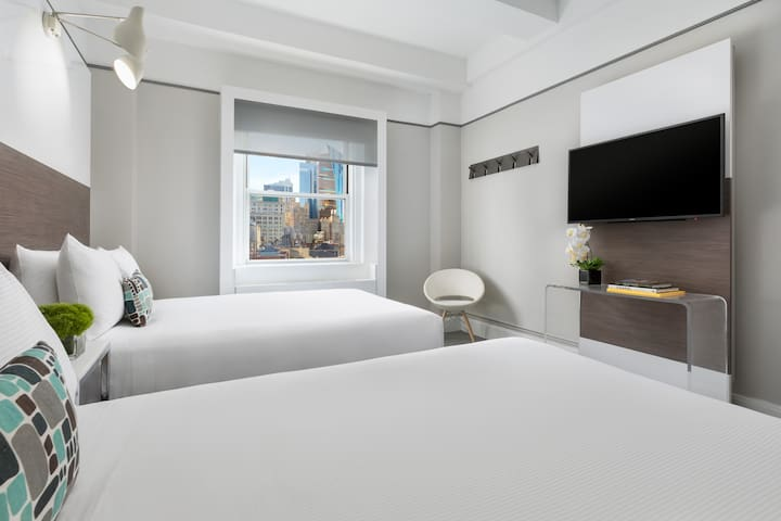 Private Room with 2 Double Beds Fits up to 4 people