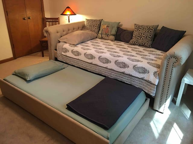 "Bedroom #2: This day bed and its mattresses are brand new (as of June 2018).  It has a pull out bed underneath, so it sleeps two. The mattresses are ""cool gel"" memory foam."