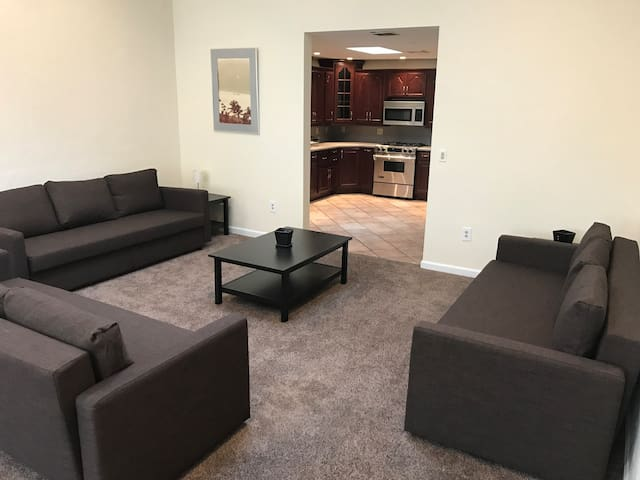 Living room with smart tv , pool table and 3 double fold out couches with pillows and bed linens underneath. For the last ones standing.