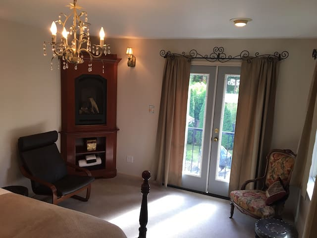 Fourth bedroom of the Estate is called French Balcony Suite for its stunning  panoramic view of Cedar and Fur trees.