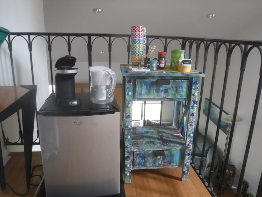 Guest fridge with cold filtered water. Single cup coffeemaker, coffee and tea.