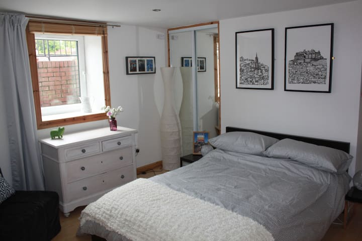 A bright basement bedroom, 1 of 2