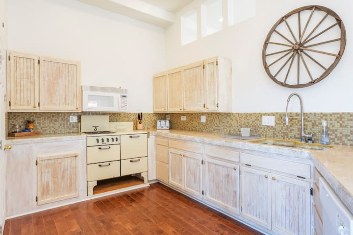 Large, fully-stocked kitchen has everything you need to cook a nice meal. Check out the reclaimed wagon wheel on display :)