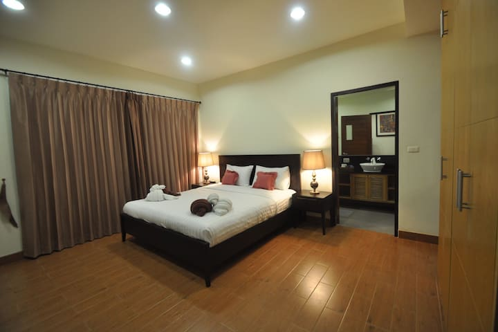 - Master bedroom with king size bed, bathroom has bath tub, 2 basin and hot water, has  balcony with outdoor chair where you can sitting and see pool view.
