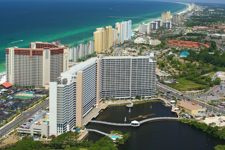 Waterfront condo w/ shared, outdoor pools, a hot tub, gym, & on-site dining