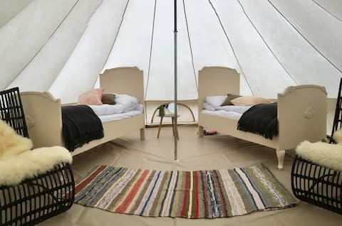 This special tentroom has both old Norwegian traditions with wooden beds and vowen carpets and cool and modern interior inside.