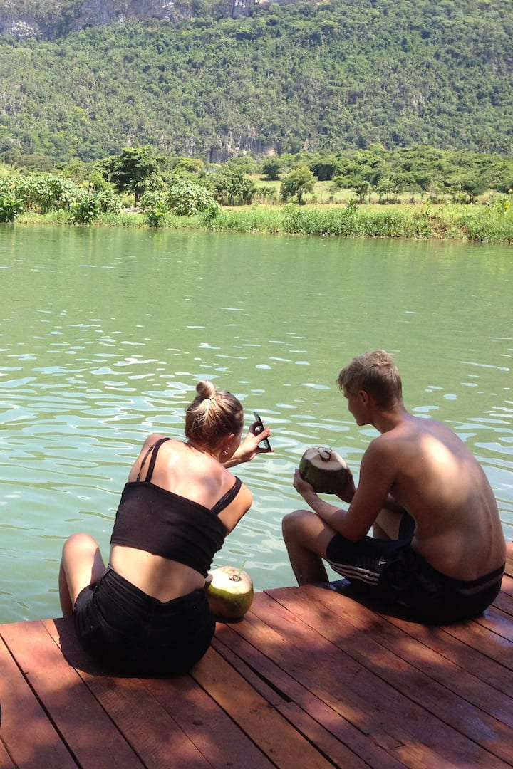 Drinking a crazy coconut in the lake