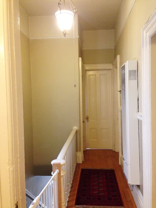 Long Hallway entrance with access to two extra Bedrooms.