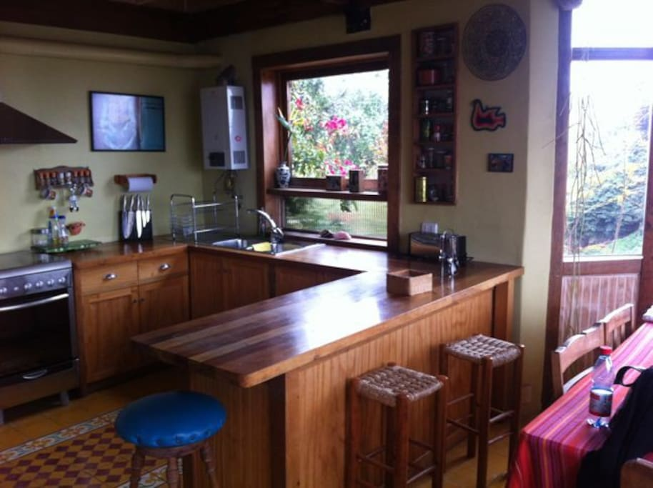Big and comfortable kitchen with dining table w/6 chairs. It has refrigerator/freezer, microwave, kitchen stove with oven and all you need for cooking.
