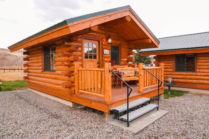 The Bunkhouse offers a beautiful, sturdy bunk bed, offering a comfortable twin bunk, over a  full-size futon (coil spring mattress) which makes out to a full-size bed.