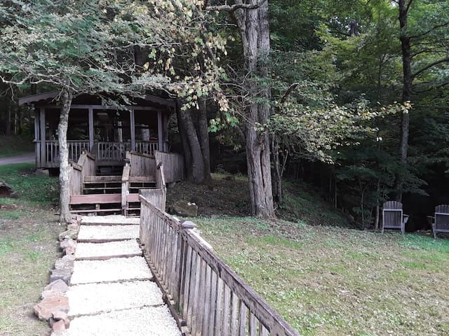 Extra large gazebo with fire pit on the property