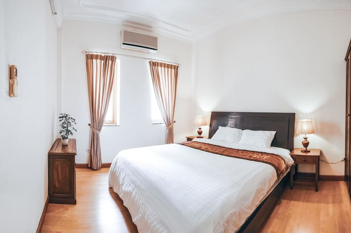 Comfortable and warmly lit bedroom where you can relax and recharge your energy for a new day