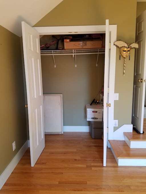 Closet space for hanging clothes.