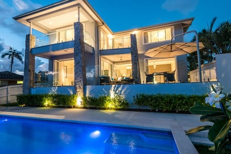 Stunning Waterfront home with private tennis court
