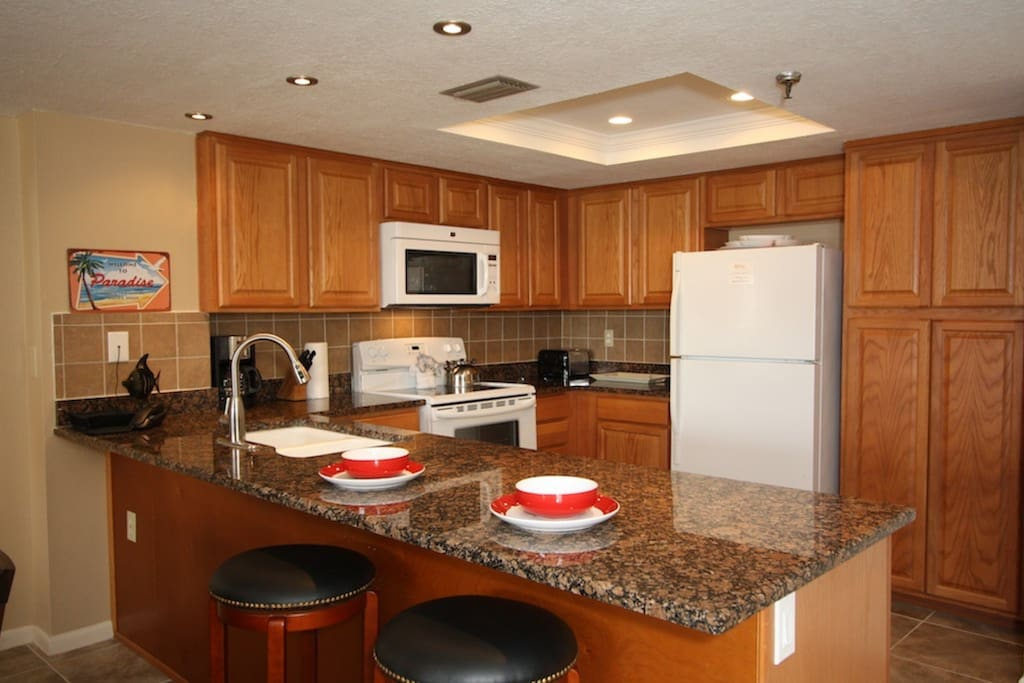 Fully equipped kitchen with bar stool seating for two