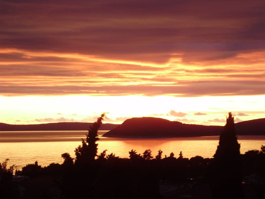 Magical view of the sunset over peninsula of Čiovo from the terrace