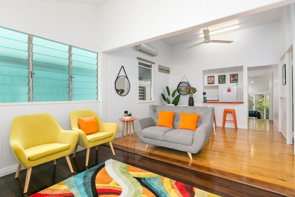 Vibrant living room with smart-tv and air-conditioning