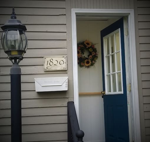 """Home to the Stationmaster of the Troy Town Depot, 78 Prospect has seen a lot of change since 1820.  Once the main entrance, this """"mid-house door"""" is rarely used.  Most guests take the short route through the garage and into the Suite hallway."""