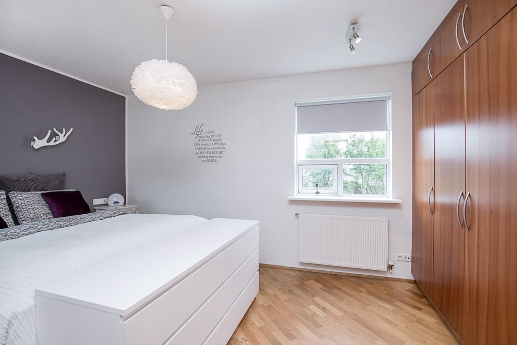 Master bedroom with a double bed and good closet space.