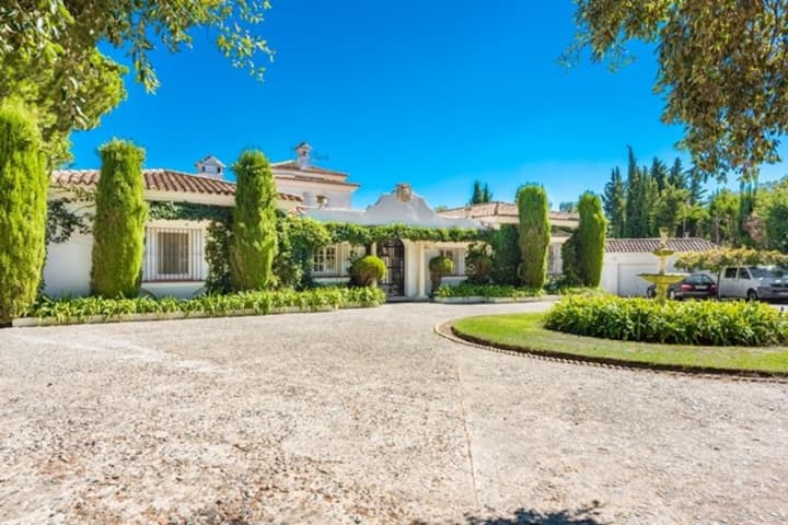 Elegant villa, set in expansive, manicured gardens